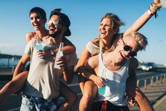Group of young happy friends having fun time Royalty Free Stock Photo