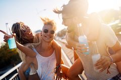Group of young happy friends having fun time Stock Photos