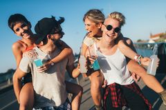 Group of young happy friends having fun time Royalty Free Stock Photos