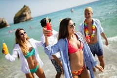 Group of happy friends on vacation having fun on beach in summer stock image