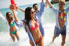 Group of happy friends on vacation having fun on beach in summer royalty free stock photos