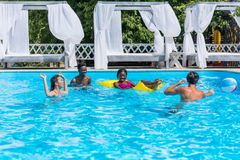 Group of young happy multiethnic people having fun together in swimming royalty free stock photo