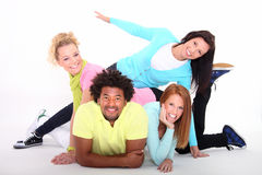 Group of young happy people. Young people lying down on a floor Royalty Free Stock Image