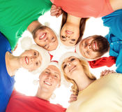 Group of young and happy teenagers in Christmas hats Royalty Free Stock Photography
