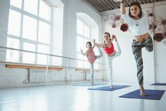 Group of young happy woman practice yoga poses indoor class. Group training stock images