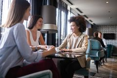 Group of young happy women drinking coffee royalty free stock photography