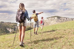 Group of young hikers in the mountain in single file Stock Photos