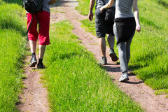 Group of young hikers walking down a trail Stock Photos