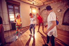 Young hip hop dancers dancing in the studio. Sport, dancing and royalty free stock photo