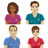 Group of young hospital workers in scrubs. Over white background Stock Photos