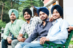 Group of young indian man sikh. Group portrait of young positive indian men sikh in turbans Royalty Free Stock Photos