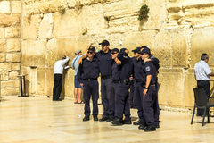 A group of young Israelis in police uniform are doing a picture in memory of the visit to the Wailing Wall Stock Image