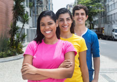 Group of young latin american and caucasian women and man in line Stock Images