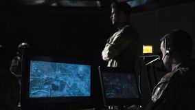 Soldiers in communications center launching missile Royalty Free Stock Photography