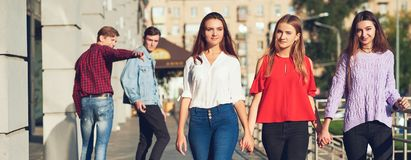 Group of young man flirting with woman in city. Stock Photography