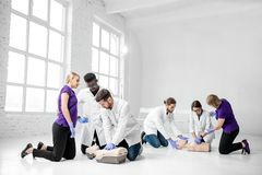 Group of medics during the first aid training indoors royalty free stock photo