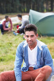 Group Of Young Men On Camping Trip In Countryside Stock Photo