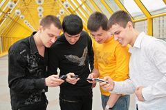 Group of young men with cell phones Stock Photo
