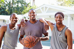 Group Of Young Men Playing Basketball Match Royalty Free Stock Images