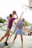 Group Of Young Men Playing Basketball Match Stock Image