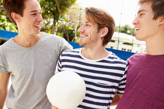 Group Of Young Men Playing Volleyball Match Royalty Free Stock Images