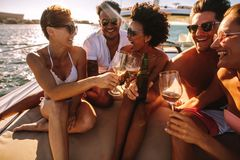 Friends having drinks on yacht deck royalty free stock photos
