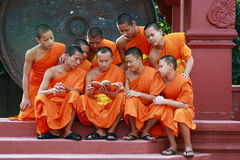 Group young monk. Viewing the book at temple Phra That Lumphang LuongThailand Stock Images