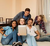 Group of young multi ethnic friends taking selfie. In home interior Stock Photo