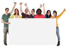 Group of young multi ethnic people holding empty banner with cop Stock Photography