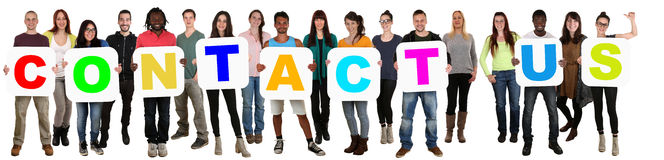 Group of young multi ethnic people holding word Contact Us Stock Photos