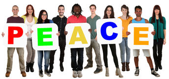 Group of young multi ethnic people holding word peace Stock Images