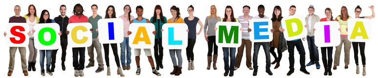 Group of young multi ethnic people holding word social media Royalty Free Stock Photography