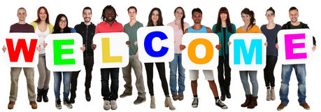 Group of young multi ethnic people holding word welcome Stock Photo