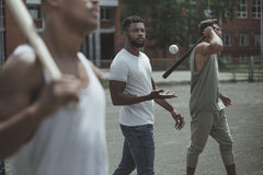 Young multiethnic male baseball players on court Royalty Free Stock Photo