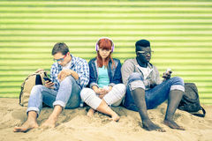 Group of young multiracial friends with smartphone at beach Royalty Free Stock Image