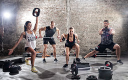 Group of young muscular people practicing stock photography