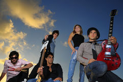 Group of young musicians posing with instruments stock photos