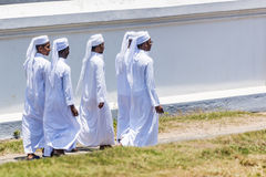 Group of young muslim men in white tunic Stock Images