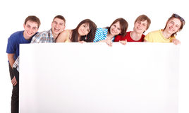 Group of young people with banner. Royalty Free Stock Image