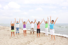 Group of young people on the beach Royalty Free Stock Photography