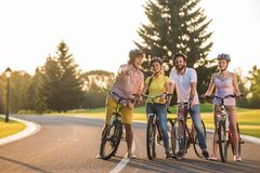 Group of young people on a bike trip. Group of joyful students on a bike ride. Spending qualitative time together royalty free stock image