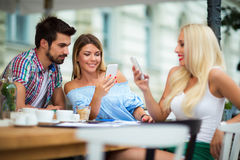Group of young people in cafe. Group of young people laughing in cafe Stock Photography