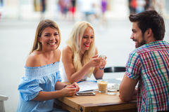 Group of young people in cafe. Group of young people laughing in cafe Royalty Free Stock Photos