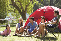 Group Of Young People On Camping Holiday Together stock images