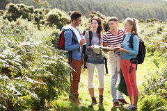 Group Of Young People On Camping Trip In Countryside. Looking At Map royalty free stock image