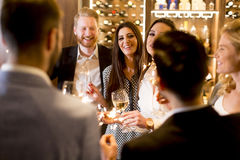 Group of young people celebrating and toasting with white wine Stock Photo