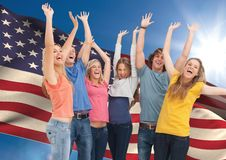 Group of young people cheering against American flag. Digital composition of group of young people cheering against American flag Stock Images