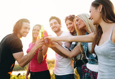 Group of young people cheering Stock Photos