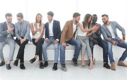Group of young people communicate in the waiting room. stock image