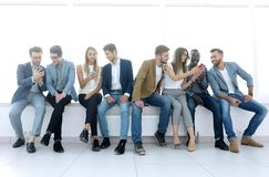 Group of young people communicate in the waiting room. stock photography